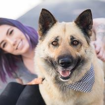 Girl with large shepherd type dog