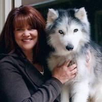 Jackie Roach with a husky dog