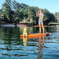 Andie and tan dog on standup paddleboard