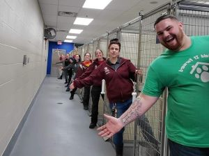 Shelter staff showing empty kennels