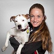 Michelle Logan holding white dog