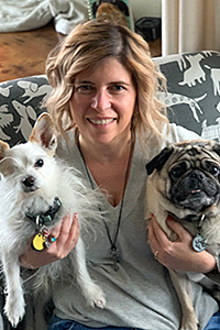 Stacy Rogers holding two dogs