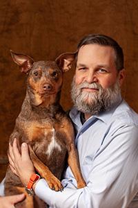 Tim Yeaglin holding brown dog