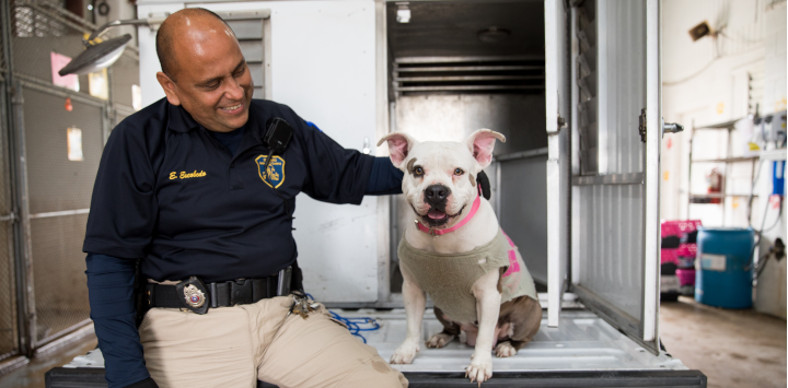 field services officer with a dog