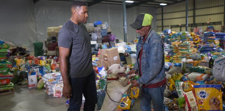 man receiving help at pet food bank
