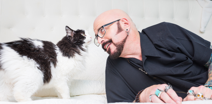 Jackson Galaxy and a black and white cat